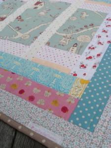 Alice In Wonderland Baby Quilt for sale.